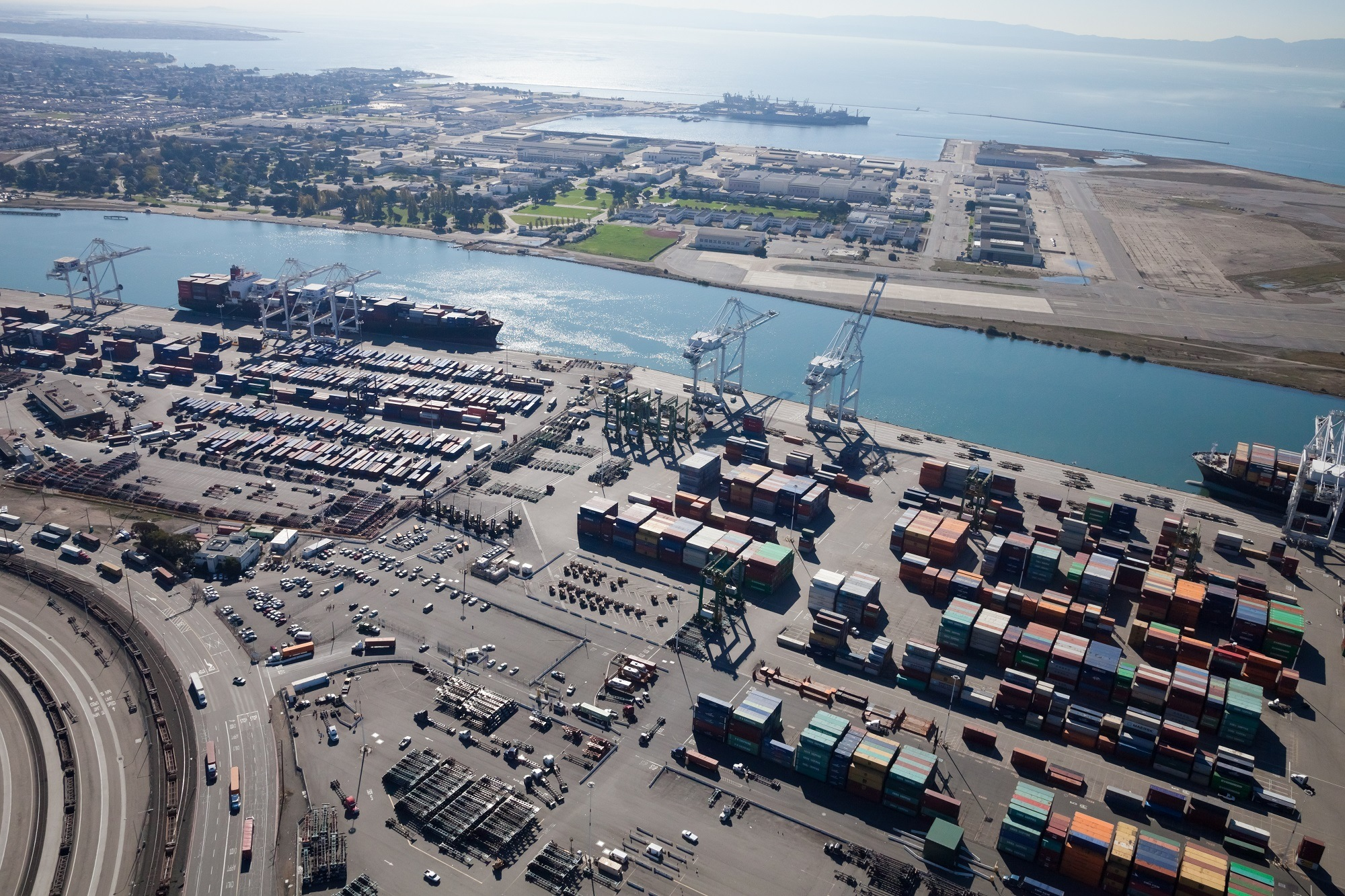 Oakland, California, USA - October 26, 2011: Port of Oakland, Middle Harbor Container Terminal. Terminal occupies 81 acres, 5 traveling container-handling cranes including 374 outlets for refrigerated cargo containers. Union Pacific Railroad operates north of facility, on opposite side of Middle Harbor Road.