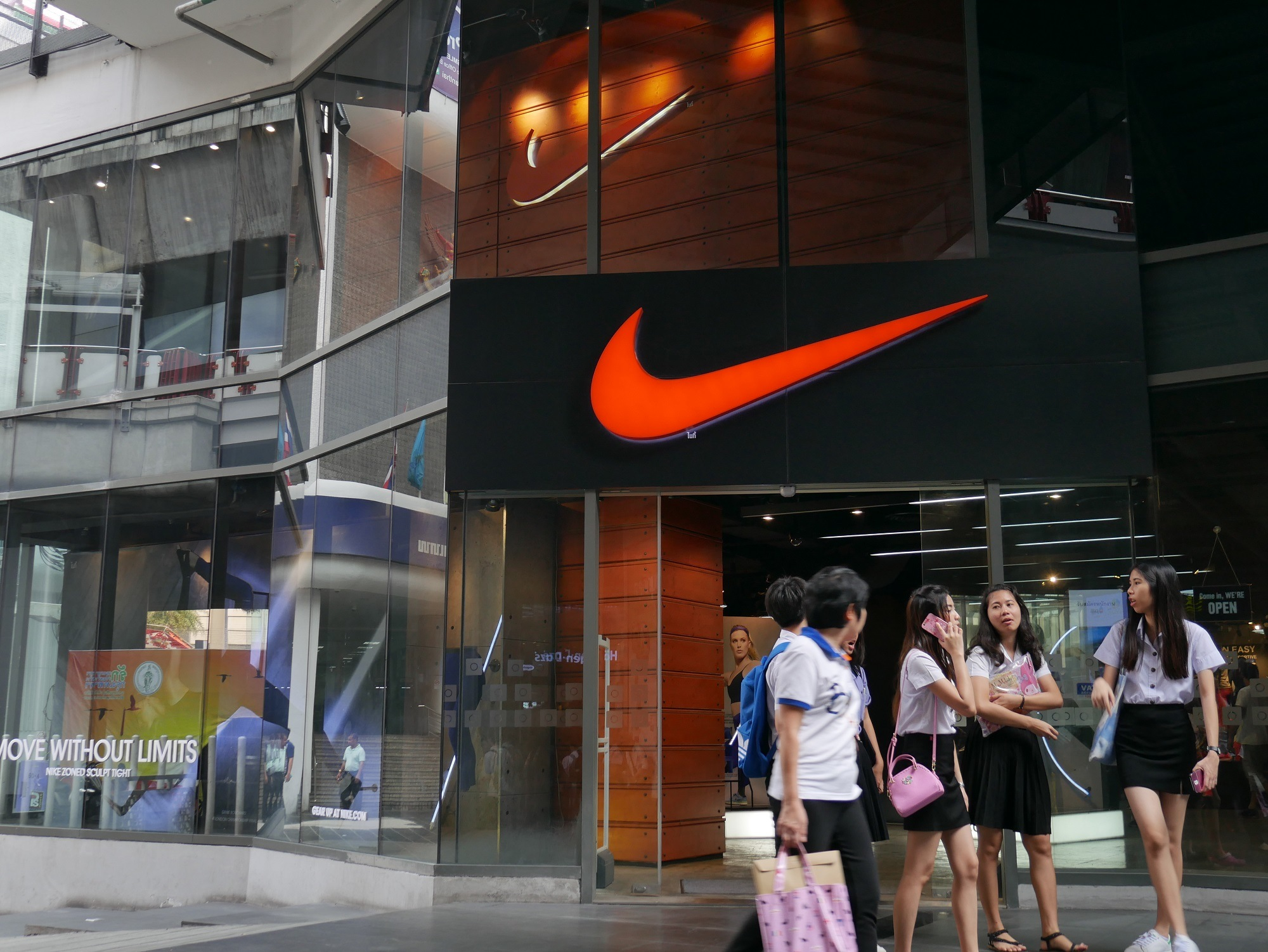 Bangkok, Thailand-February 19, 2016: Exterior view of a Nike shop in the Siam Square area of Bangkok, Thailand. People walk around the area.