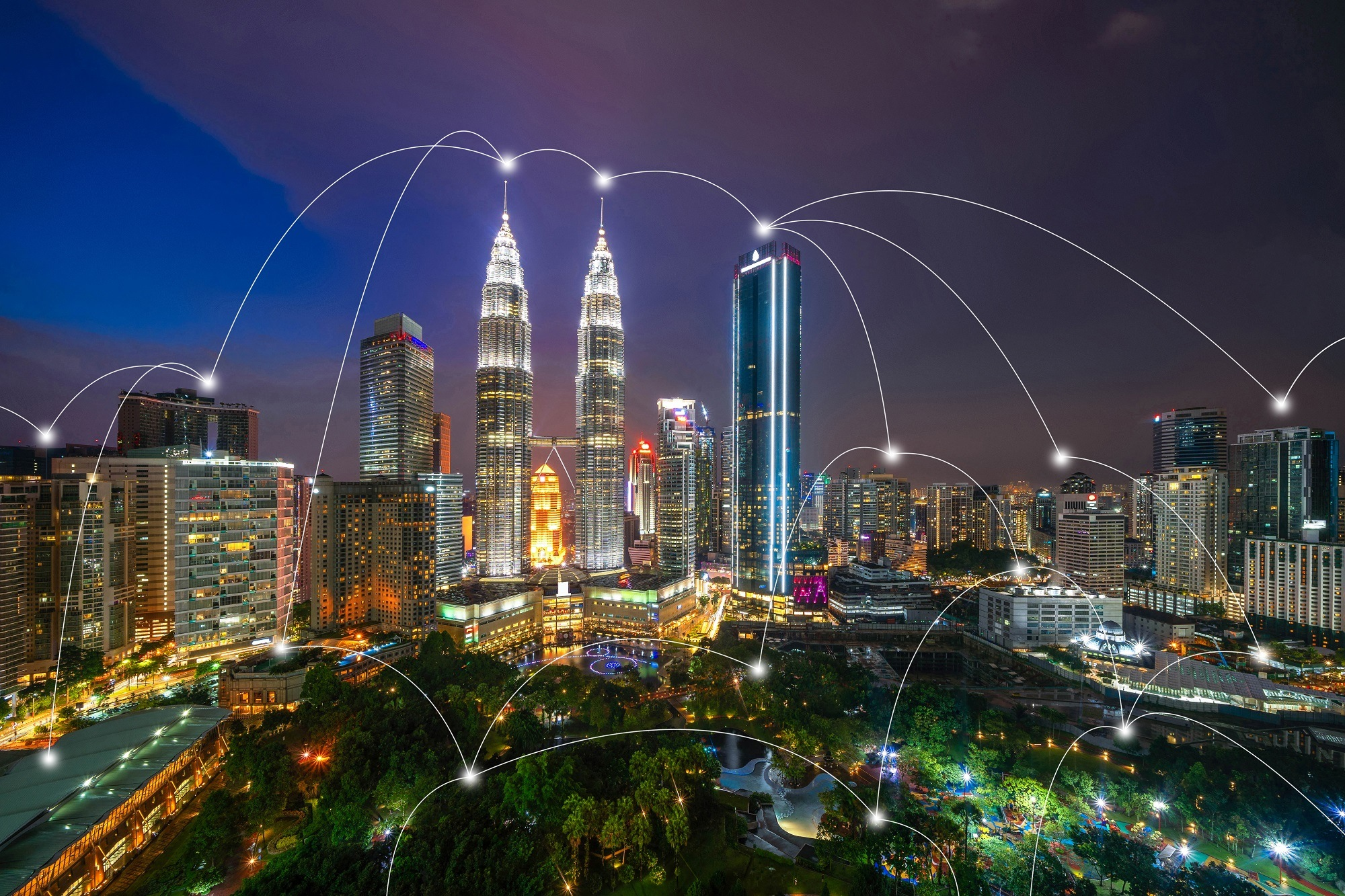Digital network connection lines of Kuala Lumpur Downtown, Malaysia. Financial district and business centers in smart city in technology concept. Skyscraper and high-rise buildings at night