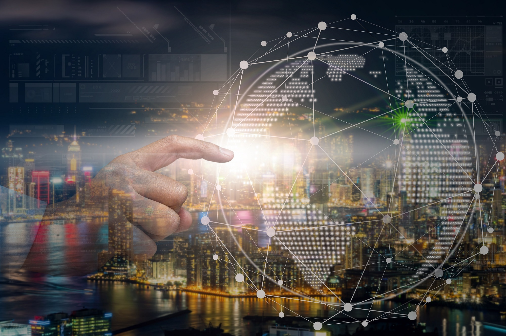 Hand touching the global network with the earth over the Hong Kong Cityscape at night time which can see down town and Victoria harbor, business innovation and technology concept