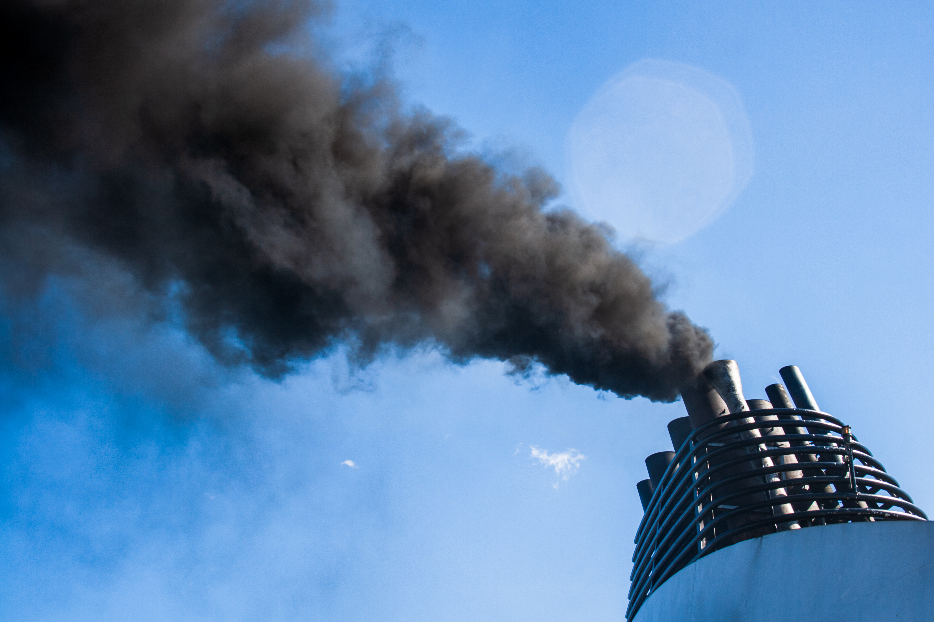 Ships funnel emitting black smoke, air pollution