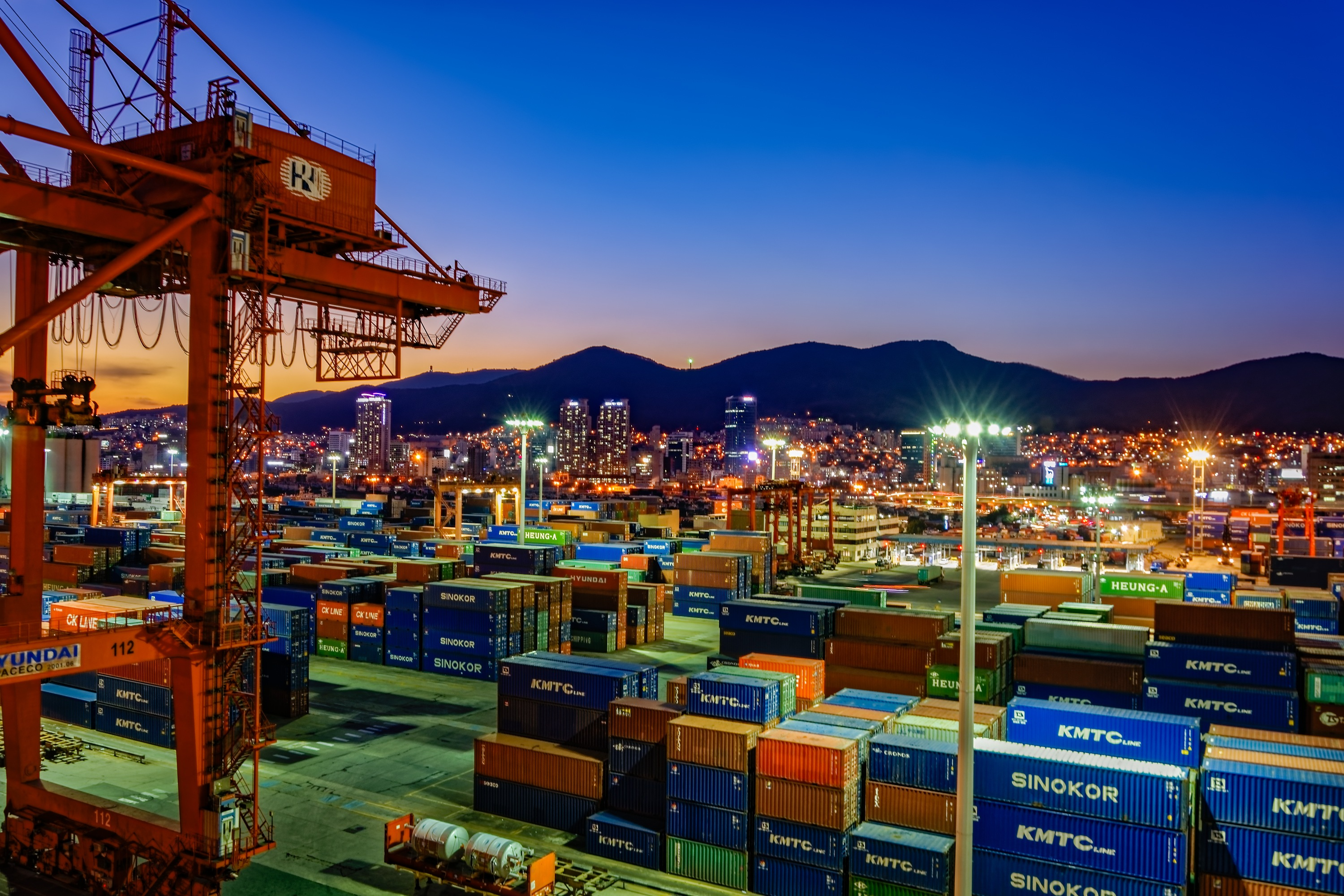 Busan: Night wide angle panorama of cargo vessel in the port of Busan, South Korea, the fifth largest container terminal harbor in the world.
