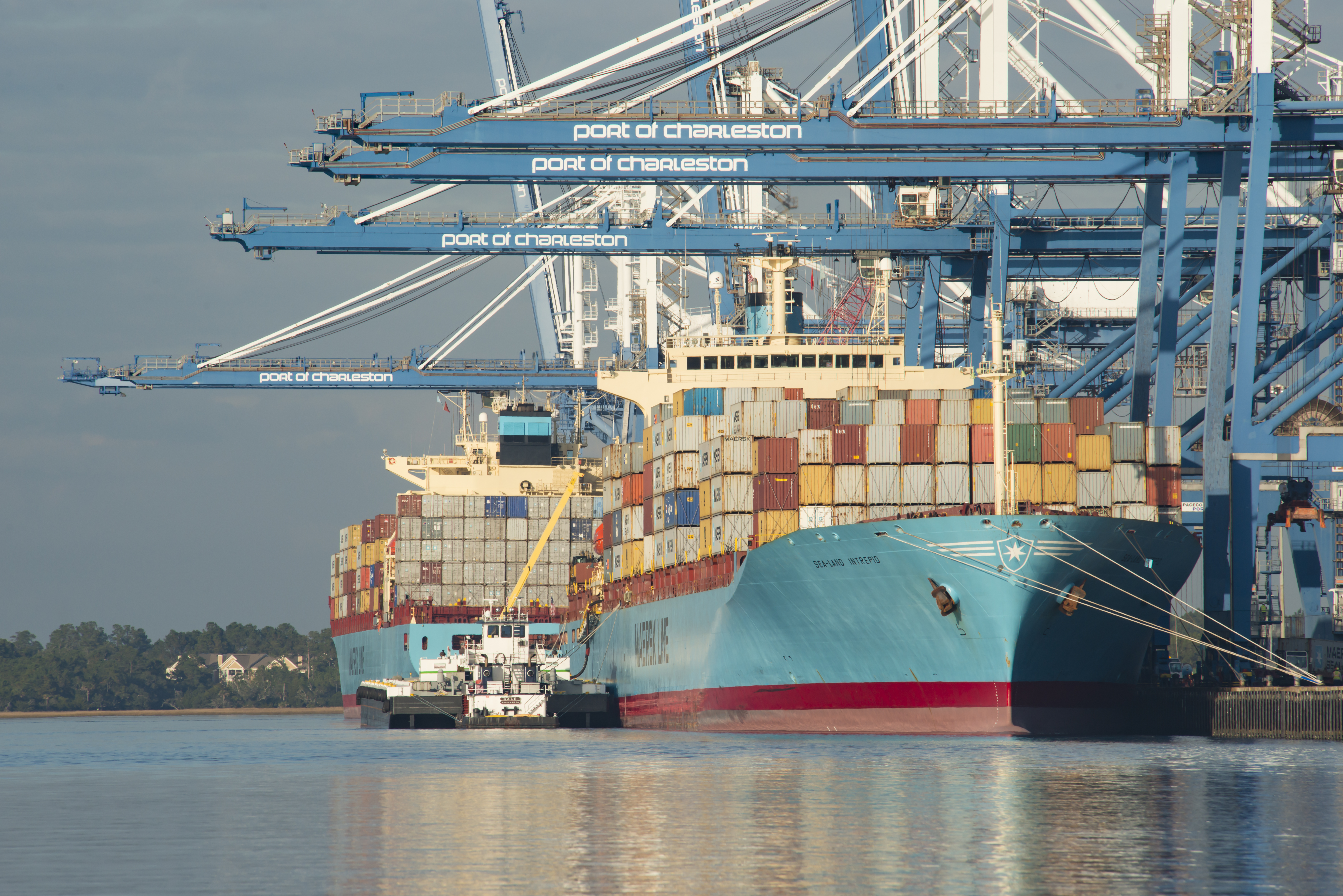 Charleston, SC, US - December 9, 2015: Taken of the Port of Charleston with cargo ships being loaded on the Cooper River.