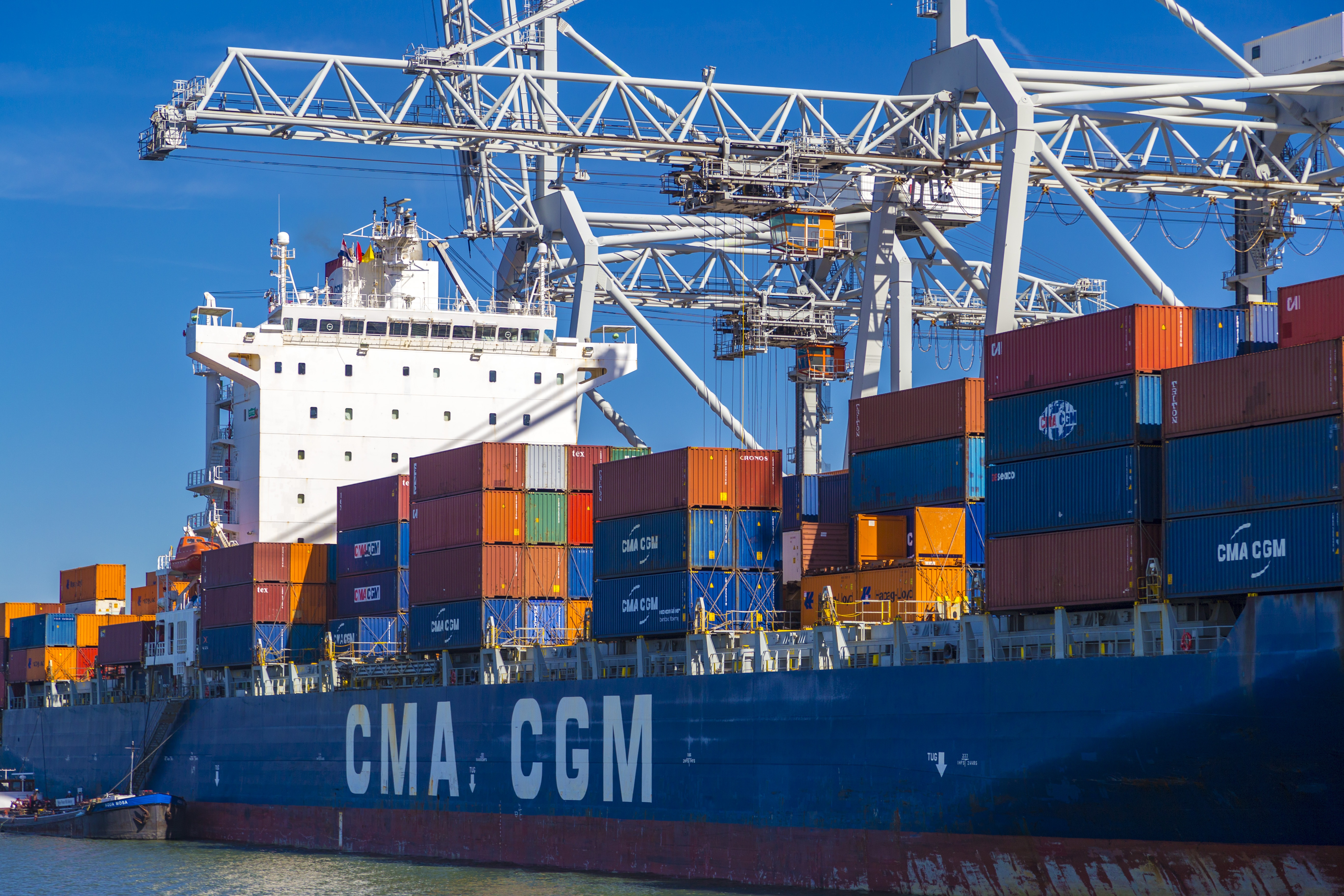 Rotterdam, Netherlands - May 24, 2015: Large CMA CGM container vessel unloaded in Port of Rotterdam, Netherlands