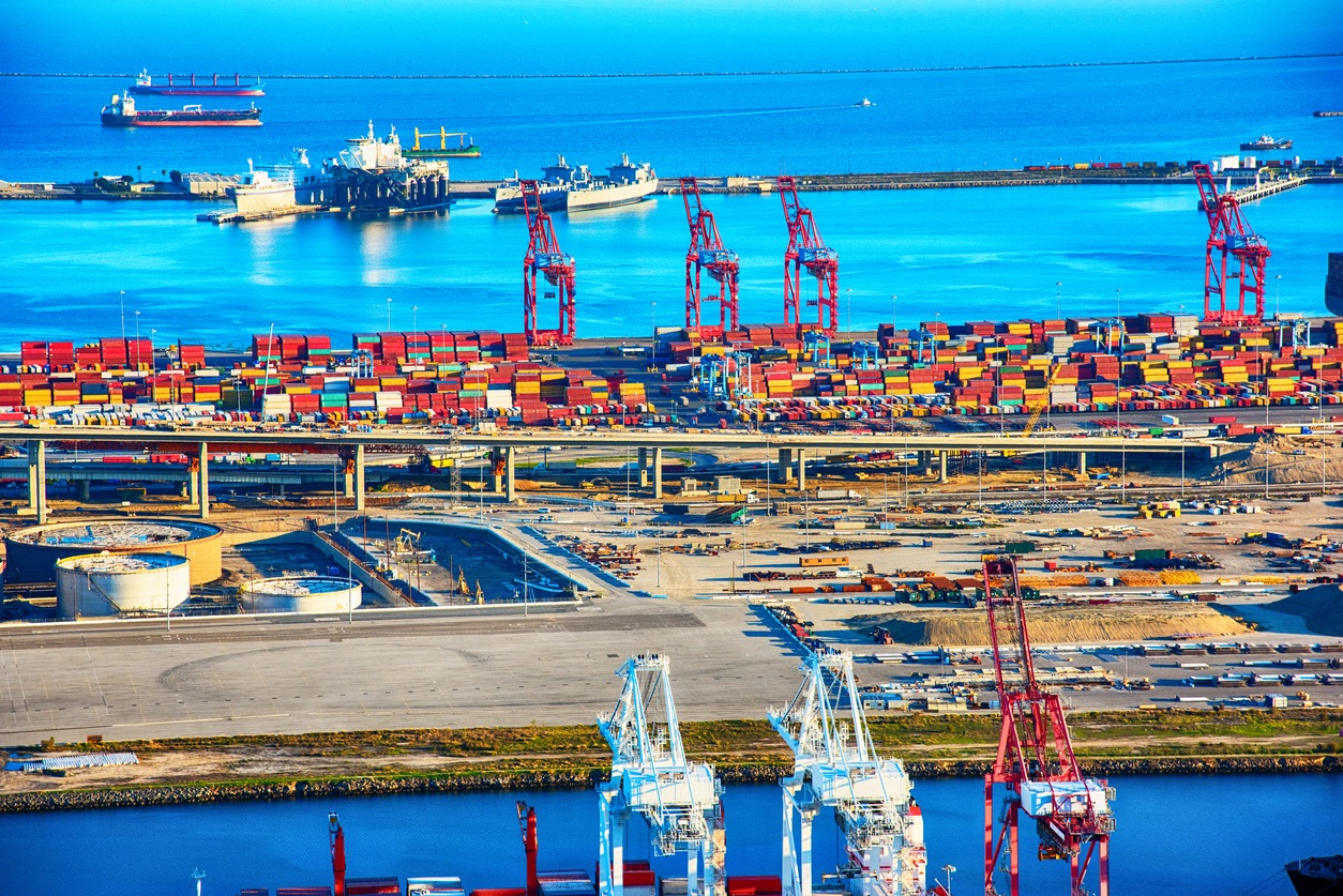 Cargo ships, containers, and cranes in the largest port in the western United States, the Port of Los Angeles located in San Pedro, California just west of downtown LA, California.  This image was shot from an altitude of about 1000 feet.