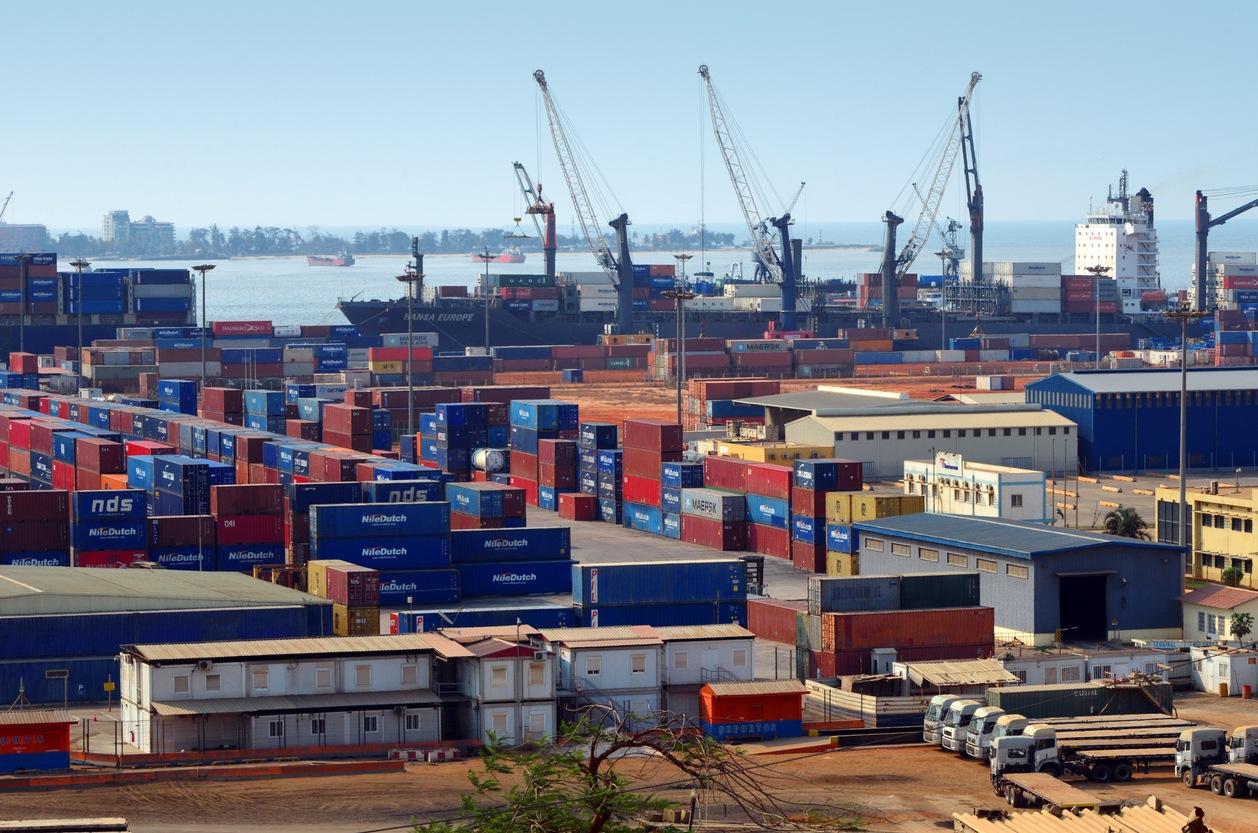 Luanda, Angola:Port of Luanda container terminal with ship unloading (Hansa Europe) - Luanda island in the background