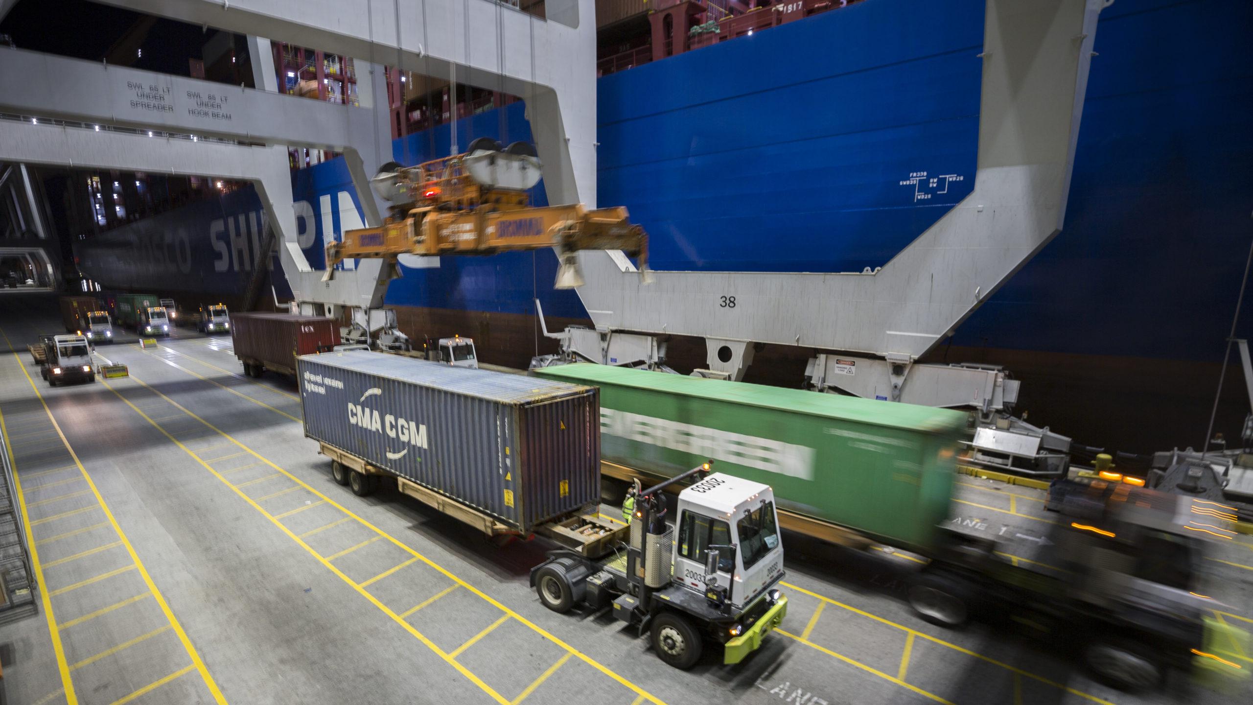 Ship to shore cranes move cargo into the night at the Georgia Ports Authority's Port of Savannah Garden City Terminal, Wednesday, March, 25, 2020, in Garden City, Ga. (GPA Photo/Stephen B. Morton)