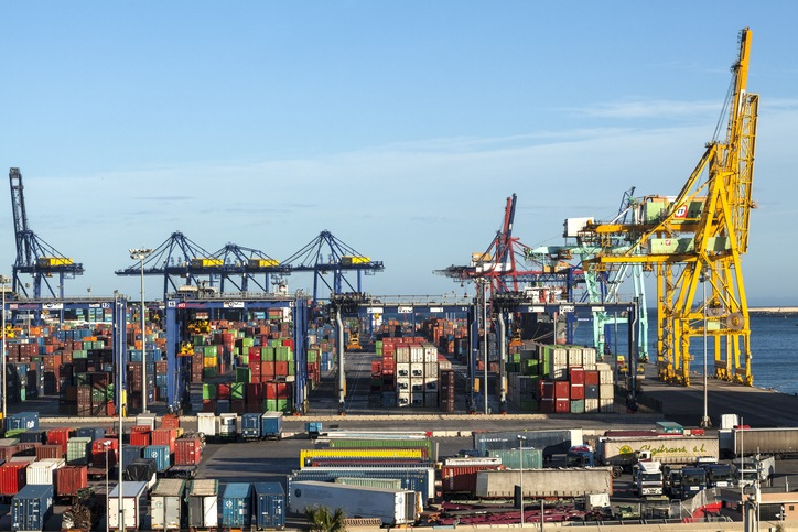 Valencia, Spain - April 28, 2014: dockside gantry cranes found at container terminals for loading and unloading intermodal containers from container ships.