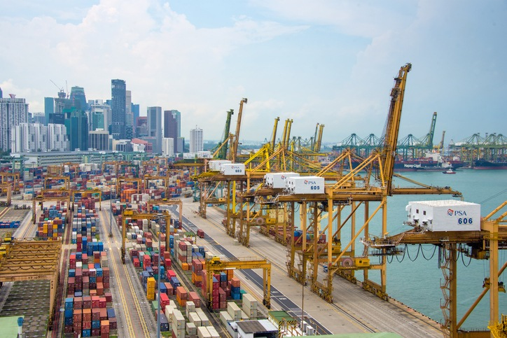 Singapore, Singapore - May 7, 2015: Aerial view of the port of Singapore, the busiest asian commercial port with cargo ships and containers