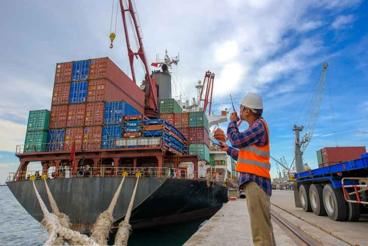stevedore foreman in charge takes control the loading discharging opertion of the handle containers accomodation on bay storage for transport shipments in port terminal