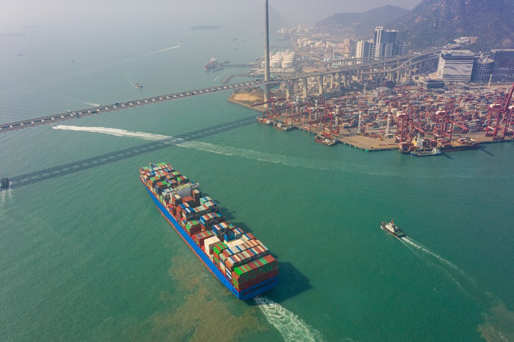 Aerial view of international port with Crane loading containers in import export business logistics at Hong Kong in China