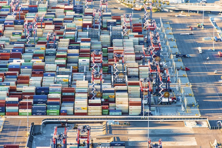 Long Beach, United States - March 28, 2018:  Outdoor storage area for numerous cargo containers delivered to the United States through the Ports of Long Beach and Los Angeles, California; the busiest seaport on the west coast of the United States, from an altitude of about 1500 feet during a helicopter photo flight.