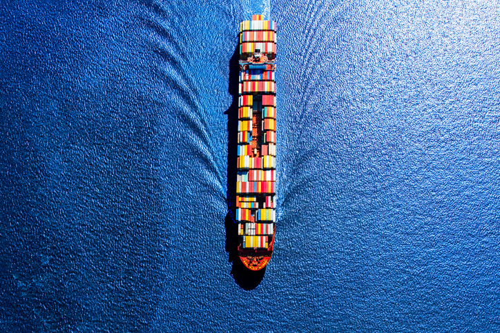 Aerial view of container ship on blue ocean