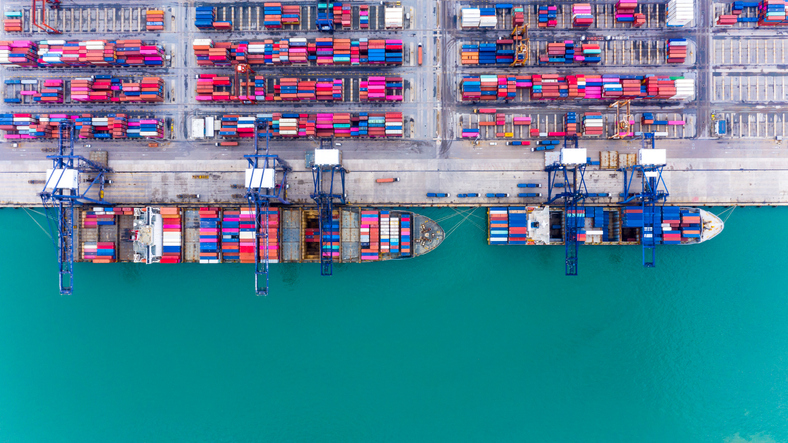 Aerial view of container port with two ships