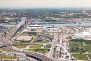 Aerial photo of the Corpus Christi Harbor Bridge including construction adjacent for the new Harbor Bridge Project for Highway 181 over the Corpus Christi Ship Channel / Port Corpus Christi