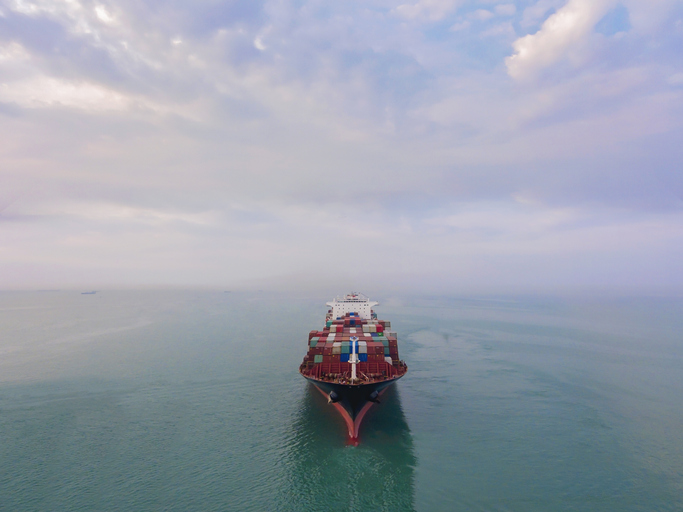 Aerial view of cargo ship in transit.