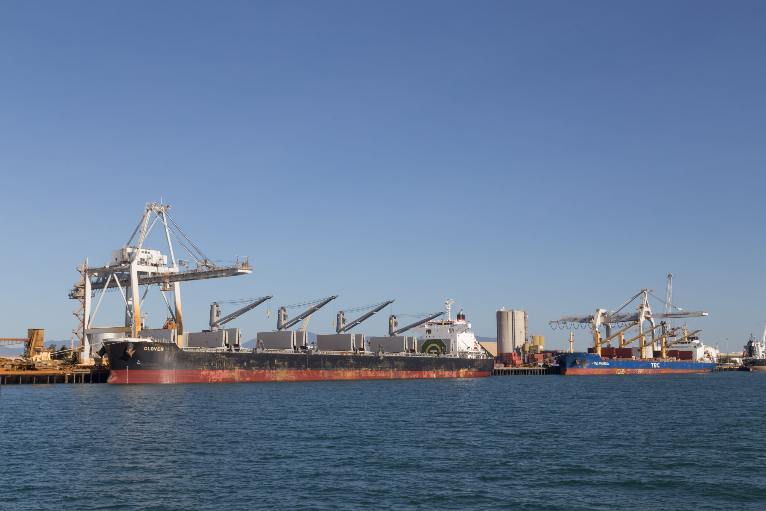Townsville, Australia - May 11, 2015: Cargo ships are being unloaded at container terminal.