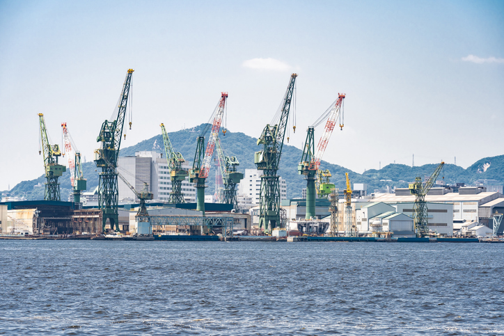 Hoisting cranes in the industrial zone of the Port in Kobe Hyogo Kansai Japan using for import export shipping and global business background