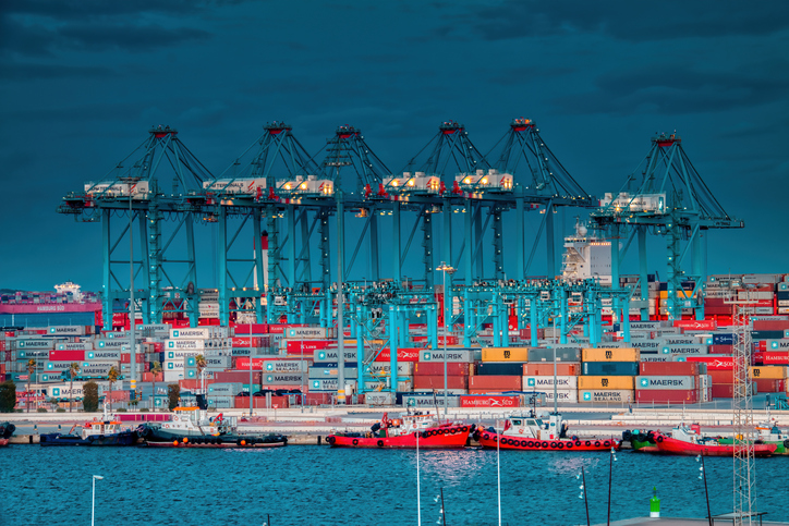 Algeciras, Cadiz, Spain - November 15, 2019: Night view of the port of Algeciras, full of containers and huge cranes.