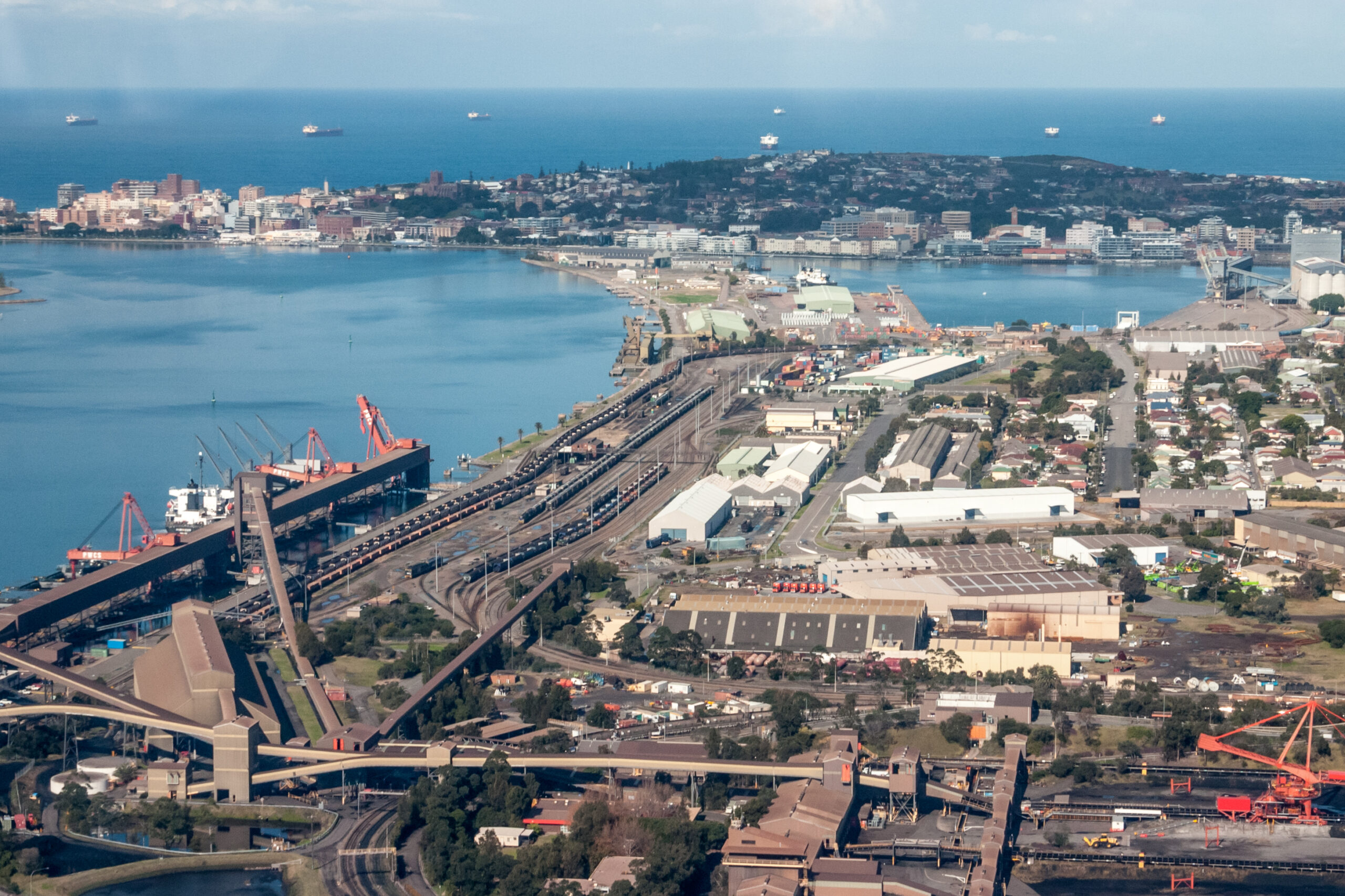 Newcastle port and coal loading facilities at Carrington. Newcastle is the largest coal export port in the world loading freights with black coal.