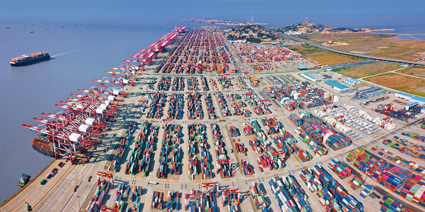 Panoramic view of Shanghai Yangshan Port on Yangshan Island with container ships, cranes and container