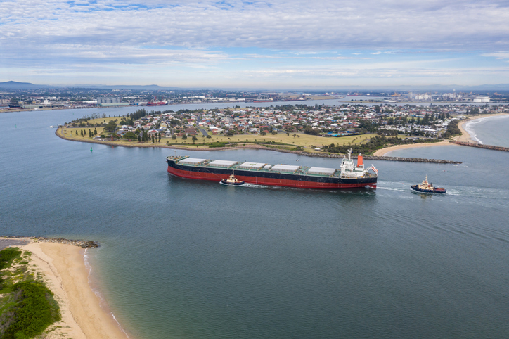 A large coal transport ship entering Newcastle Harbour - Newcastle is one of the largest coal export ports in the world providing thermal and coking coal to Asia and beyond.