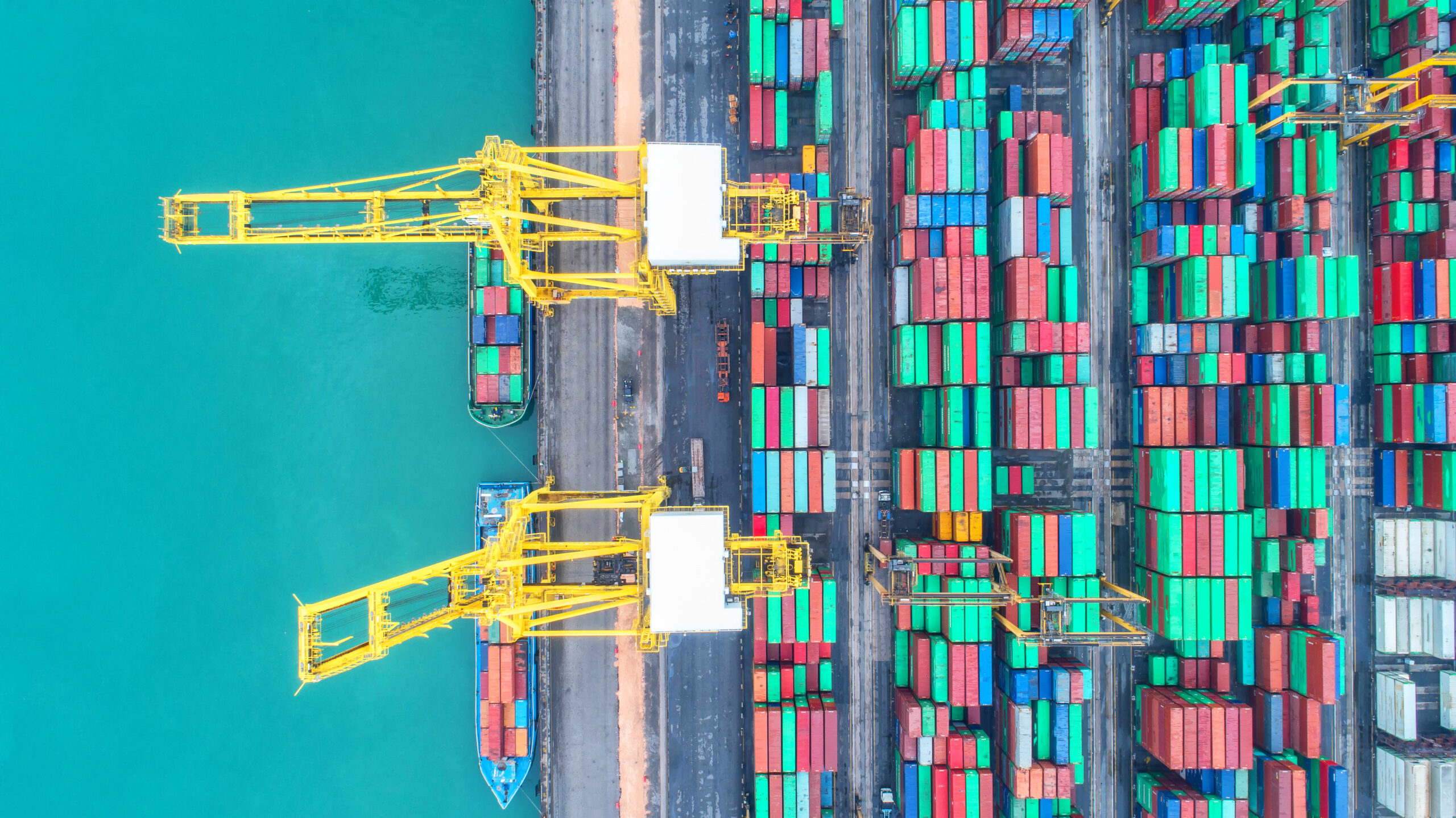 Container ship in export and import business and logistics. Shipping cargo to harbor by crane. Water transport International. Aerial view and top view