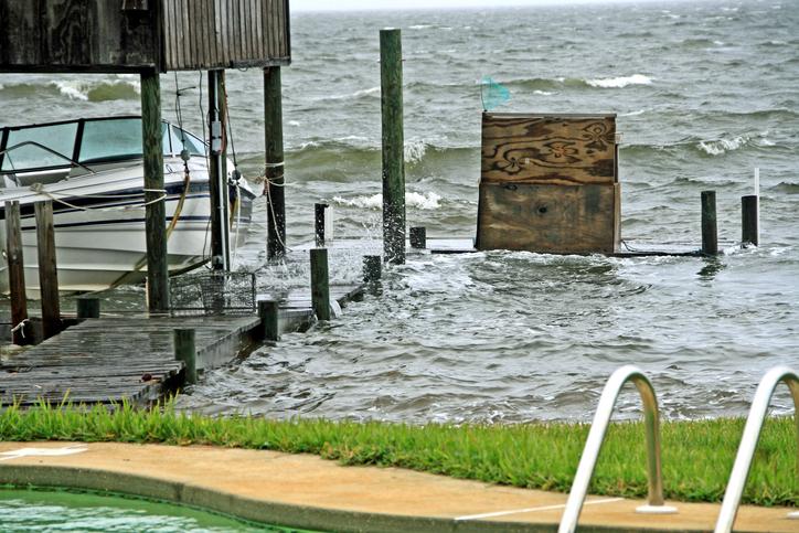 Pensacola Perdido Bay Florida high waves crashing on wood boat dock