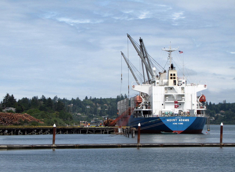 International Longshore & Warehouse Union Local 12 members load the log ship Mount Adams at Ocean Terminals in North Bend, Ore. The logs will be exported to markets in China.