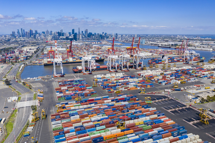 Melbourne, Australia - Nov 25, 2018: Aerial photo of the Port of Melbourne container terminal with Melbourne CBD in the background. It is Australia's busiest cargo port