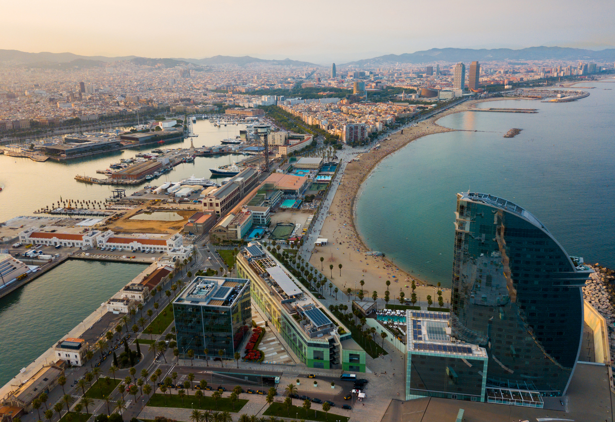 Aerial view of La Barceloneta   district of Barcelona, Spain. Beach, port and cityscape