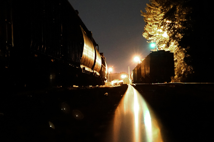 Freight train yard at night.